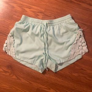 blue flowy shorts with floral design on side